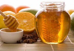 fresh honey with honeycomb, spices and fruits